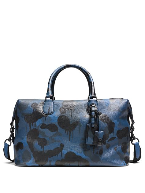 coach explorer camo print leather duffle bag  blue lyst