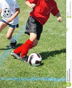 Soccer Player Chasing Ball Stock Image - Image: 2791661