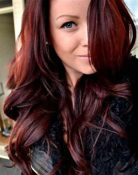 Medium length black hairstyles with plum highlights