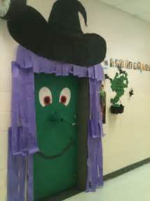 classroom door decoration for halloween a green witch