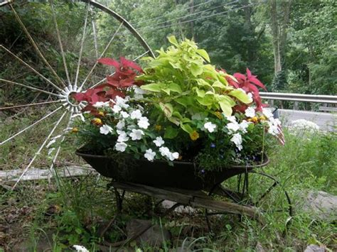 flower planter ideas 25 wheelbarrow planter ideas for your garden garden lovers club