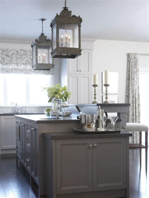 warm gray kitchen island  pendant lanterns hgtv