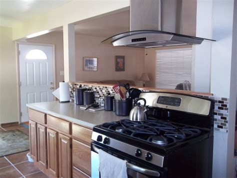 Oak Kitchen Cabinets with free standing vent hood   RTA