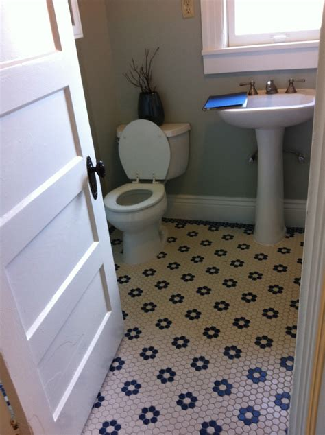 black and white hexagonal tile floor laundry mud room