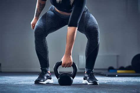 kettlebell squat exercises fat belly woman gain gym lose butt muscle beginner dumbell fitness getty effective crazy shape close exercise