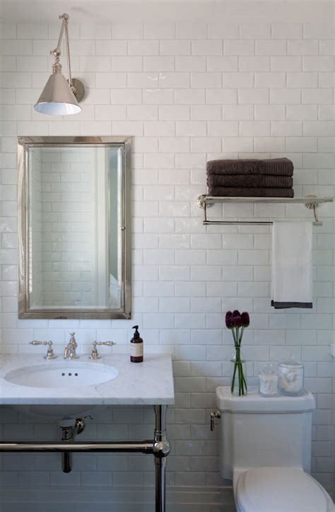 light over wall mounted medicine cabinet over the toilet shelf transitional bathroom marie