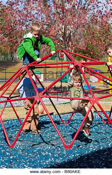 daycare play stock photos amp daycare play stock images alamy 270 | preschool boys playing on jungle gym playground equipment at preschool b80ake