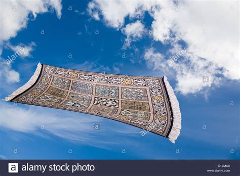 Magic Carpet Flying Through A Blue Sky With Fluffy White