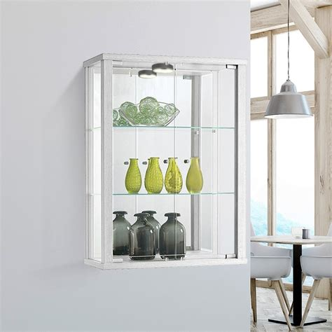 white wall mounted glass display cabinet with lighting