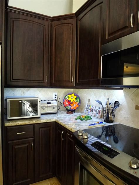 how to hang a microwave under a cabinet under cabinet lighting backless slide in range and
