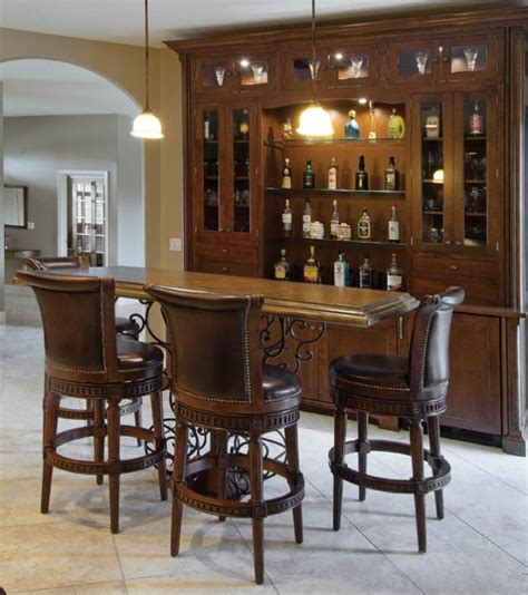 Dining Room Trim Ideas - old world tuscan design meets new age entertaining in this dining area of a kitchen remodel