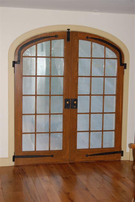 custom built wood french doors interior exterior arch top