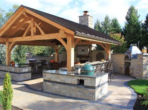Rustic Covered Outdoor Kitchen With Bar