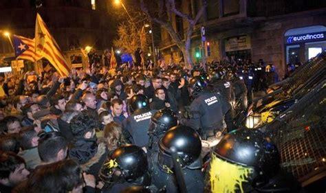 violent protests break   barcelona riot police