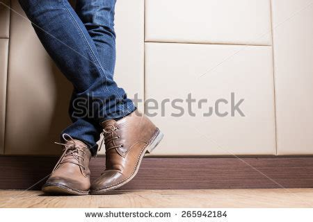 Young Fashion Mans Legs Blue Jeans Stock Photo