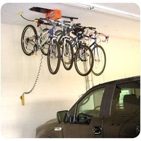 Electric Ceiling Mount Bike Lift by 25 Best Ideas About Garage Ceiling Storage On