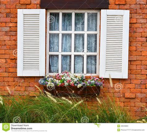 open brick wall open white window on red brick wall stock photo image