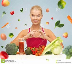 Happy Woman With Vegetarian Food Showing Heart Stock Photo ...