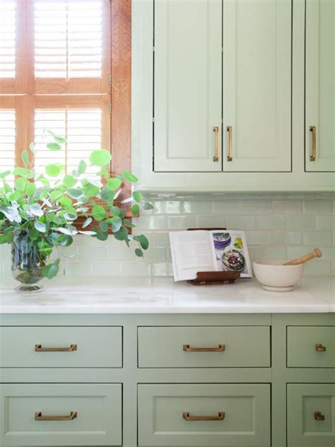 pale green cottage kitchen  modern appliances