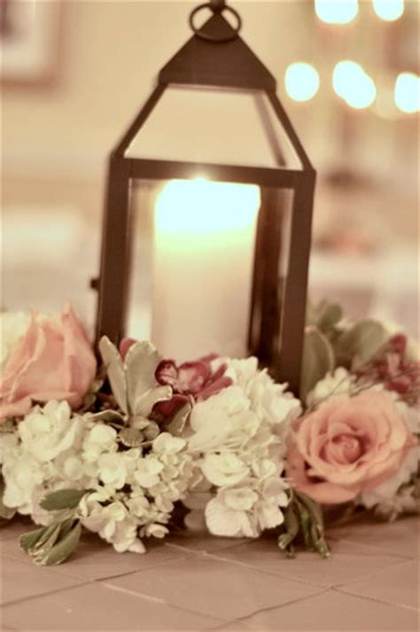 lantern  flowers centerpieces southern productions