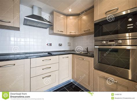 Modern Wooden Kitchen With Silver Appliances Stock Image