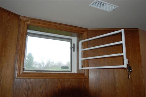 Home Bar Canada by Hinged Removable Bar Hinged Basement Window Bar 1