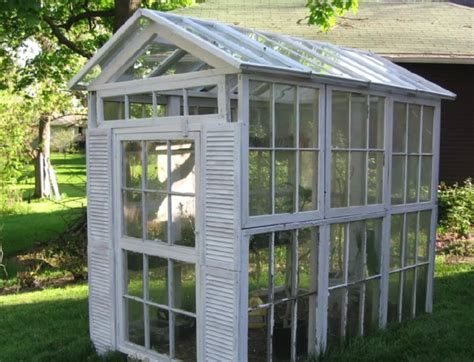 Used mexican roofing tiles from a mansion in fort worth frame the hydrangea greenhouse built from 45 old windows from all different places. 10+ Greenhouses Made From Old Windows and Doors | Home ...