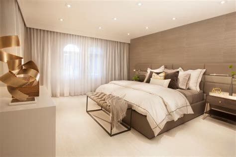 gray accent wall adds texture  calm modern bedroom hgtv