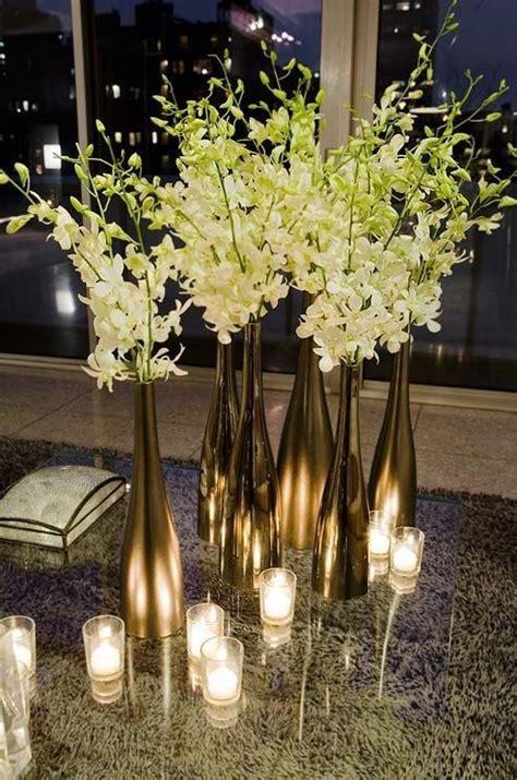 metallic wine bottles and white flowers for an elegant