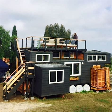 couples paspin tiny house  wheels  rooftop deck