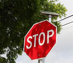 Flashing, Stop, Signs, Installed, At, Busy, Downtown, Intersection