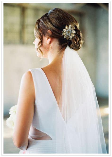 wedding hair style low bun veil underneath clip