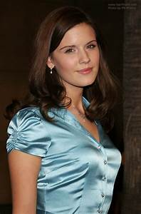 Maggie, Grace, Sporting, A, Long, Hairstyle, And, Wearing, A, Blue, Satin, Blouse
