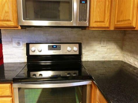 black pearl granite on medium wood cabinets traditional