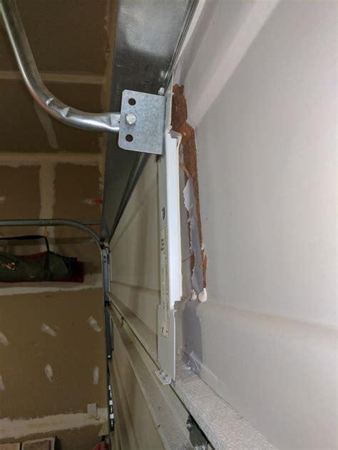 garage door operator bracket repair how do i repair a broken garage door opener arm bracket