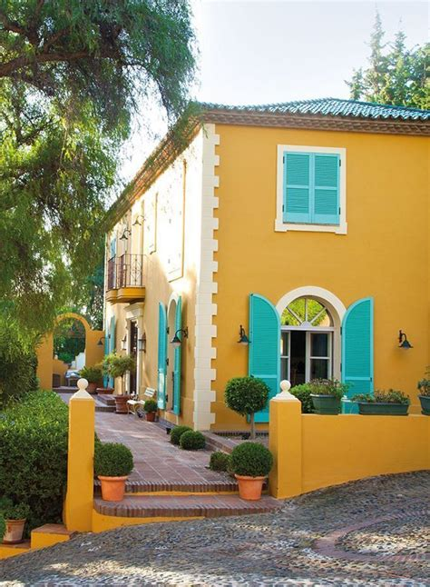 mexican yellow paint color yellow house with aqua blue detail home outside