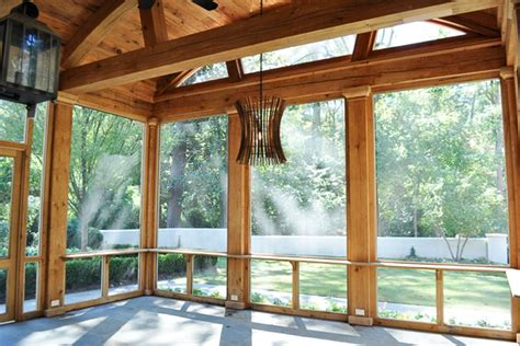 reclaimed wood rustic screened porch with reclaimed beams