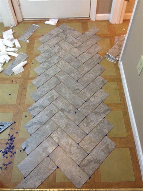 Vinyl Tile For Bathroom Floor by Diy Herringbone Vinyl Tile Pattern Via Grace Gumption