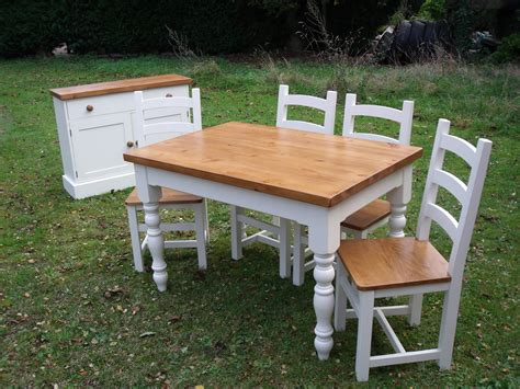 painted farmhouse table and chairs with matching sideboard