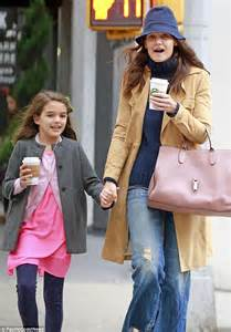 Katie Holmes and lookalike daughter Suri walk hand in hand as they bundle up for a coffee run in