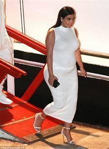 Kim Kardashian keeps her balance in stilettos aboard Khloe ...