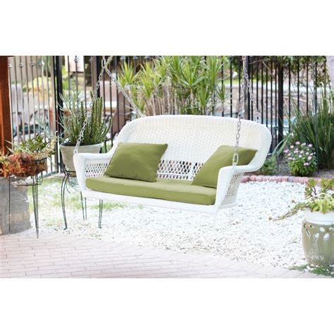 white resin wicker porch swing  sage green cushion