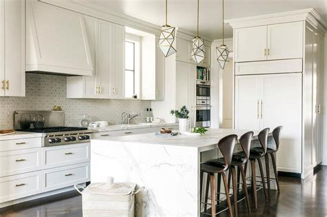 honed white marble waterfall kitchen island transitional