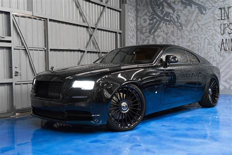 Out Black murdered out rolls royce wraith keeps the on the