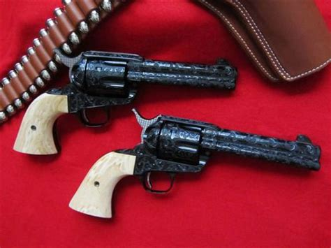 two genuine colt sixguns in 45 lc master blued with fitted ivory grips and scroll