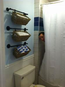 34 best images about bathroom storage ideas on pinterest for Storing towels in the bathroom