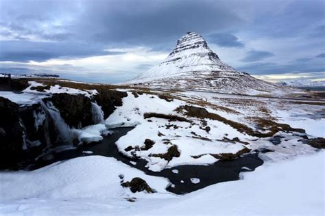 Kirkjufell Church Mountain Covered In Snow With A Frozen