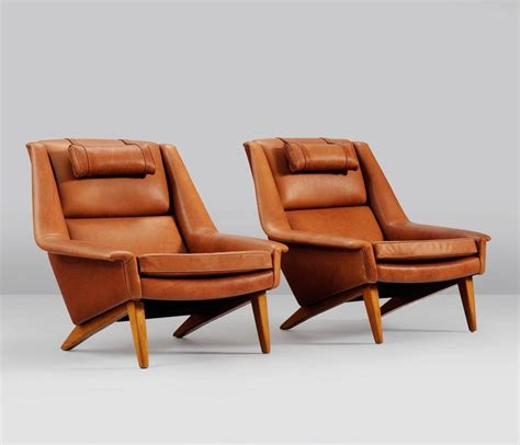 set of two reupholstered lounge chairs in cognac