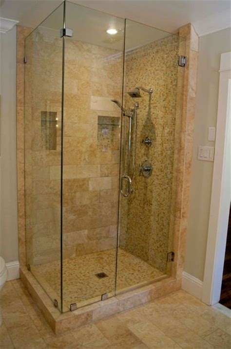 clear glass shower stall with marble tile bathrooms