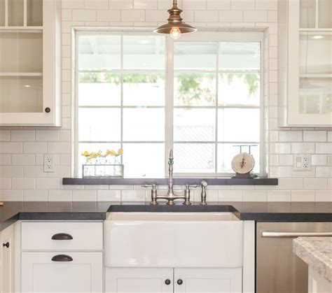 how to tile a kitchen window sill white subway tile white cabinets window black 9583